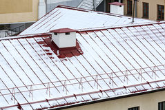 Snowy roof with chimney royalty free stock images