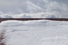 Snowy roof and cloudy sky Royalty Free Stock Photography