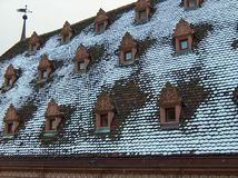 Snowy roof. With small windows in Strasbourg.France stock photography