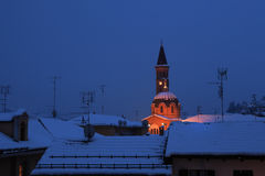 Snowy roofs and church in Alba, Italy. Stock Image