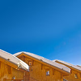 Snowy roofs of mountain wooden cabins Royalty Free Stock Photo