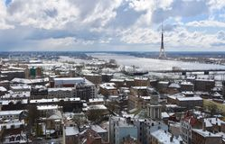 Snowy roofs and TV tower in Riga royalty free stock photos