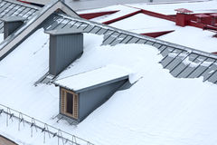 Snowy roofs viewed from above stock images