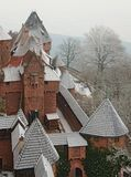 Snowy Castle Rooftops Cone / Triangle Pattern in F. Snowy fortified castle rooftops at Chateau du Haut-Koenigsbourg medieval castle in France Royalty Free Stock Images