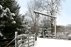 Snowy Rustic Driveway Entrance in Country Stock Image