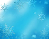 Snowy scene. Snowflakes falling in a blue haze Royalty Free Stock Photography