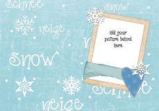 Snowy scene christmas card template. A pale blue snow themed seasonal or christmas card template.  A place to add your own photo or picture will complete the Royalty Free Stock Photo