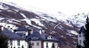 Snowy scene, Sierra Nevada. Snowy mountain and houses, Sierra Nevada, Spain Stock Photos