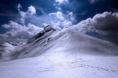 Snowy and shiny mountain top Royalty Free Stock Photography