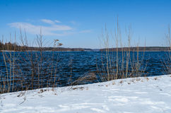 Snowy shore of Glienicke lake on Havel river Stock Photography