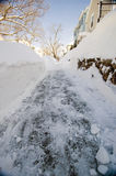 Snowy side walk in neighborhood Royalty Free Stock Images