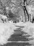 Snowy Sidewalk in Black and White. Snow piled up on a sidewalk after a fresh snowfall Royalty Free Stock Photography