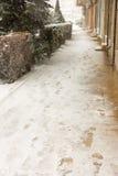 Snowy sidewalk town of Pomorie, Bulgaria, 31 december stock image