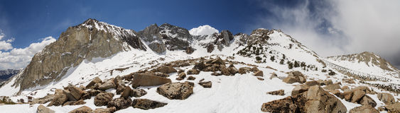 Snowy Sierra Nevada Mountains Panorama. Panorama of snowy Sierra Nevada Mountains near Bishop California including Mount Locke Checkered Demon Mount Humphreys Stock Photo