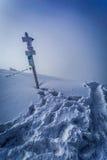 Snowy signpost on a mountain peak Royalty Free Stock Photo