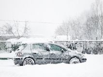 Snowy silver car Stock Photography