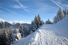 Snowy ski piste in mountains Stock Photography