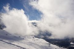 Snowy Ski Slope in Lenk, Adelboden, Switzerland. Snowy Alpine Ski Slope in Lenk, Adelboden, Switzerland with Sun and Clouds Stock Photography