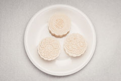 Snowy skin mooncakes. Chinese mid autumn festival foods. Traditional mooncakes on table royalty free stock images