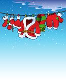 Snowy sky with Christmas costume Stock Photos