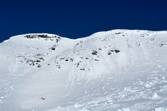 Snowy slope. Against the blue sky Stock Images