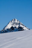 Snowy slope and mountain Stock Photography