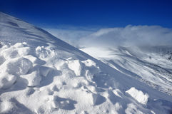 Snowy slope in the mountains Royalty Free Stock Photo