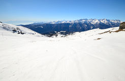 Snowy slope with superb panoramic view Stock Photo