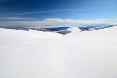 Snowy slope with superb panoramic view Stock Images