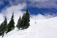 Snowy slopes. And cloudy sky Royalty Free Stock Images