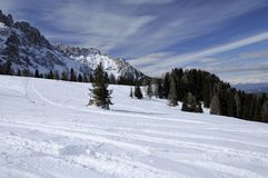 Snowy slopes at costalunga pass, dolomites Stock Photos