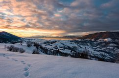Snowy slopes in mountains at sunrise Stock Photography