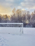 Snowy soccer field Royalty Free Stock Photo