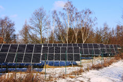 Snowy solar power Station in the winter Nature Stock Images
