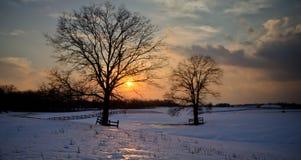 Snowy-Sonnenuntergang Stockbild