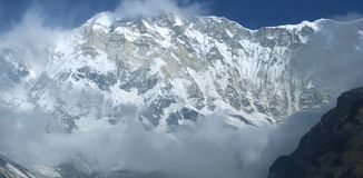 Snowy southern wall of the main peak Annapurna, eight thousandth. Trekking to Annapurna Base Camp, Nepal royalty free stock photo