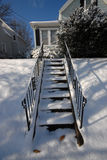 Snowy stairs. Stairs covered in snow in front of a house after a storm Royalty Free Stock Images