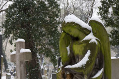 The snowy Statue from the mystery old Prague Cemetery, Czech Republic Royalty Free Stock Photo