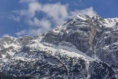 Snowy steep mountain ridge Stock Photo