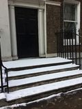 Snowy steps. A portrait of snow capped steps at a porch in London Royalty Free Stock Photo