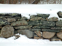 Snowy Stone Wall 2. A stone wall covered in winter snow Royalty Free Stock Photography
