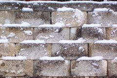Snowy stone wall on a cold winter day royalty free stock photos