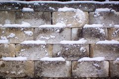 Snowy stone wall on a cold winter day royalty free stock images