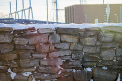 Snowy stone wall in the sun. Snowy stone wall on a bright afternoon. Taken in Beauharnois, Québec, Canada Royalty Free Stock Photography