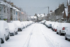 Snowy street. Parked cars in snow in residential street Royalty Free Stock Photo