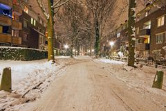 Snowy street in Amsterdam the Netherlands at night. Snowy street in Amsterdam the Netherlands in winter at night Royalty Free Stock Photo