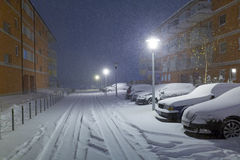 Snowy street with cars after winter snowfall Stock Photo