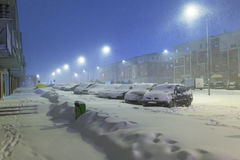 Snowy street with cars after winter snowfall Stock Image