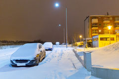 Snowy street with cars after winter snowfall Royalty Free Stock Images