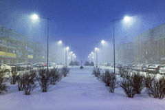 Snowy street with cars after winter snowfall Stock Photography